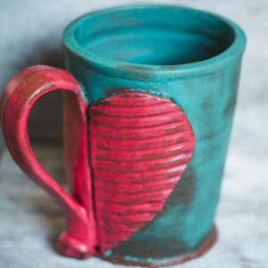 handmade clay mug and a hug
